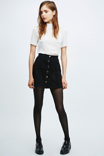 white mock neck top with black button front denim skirt