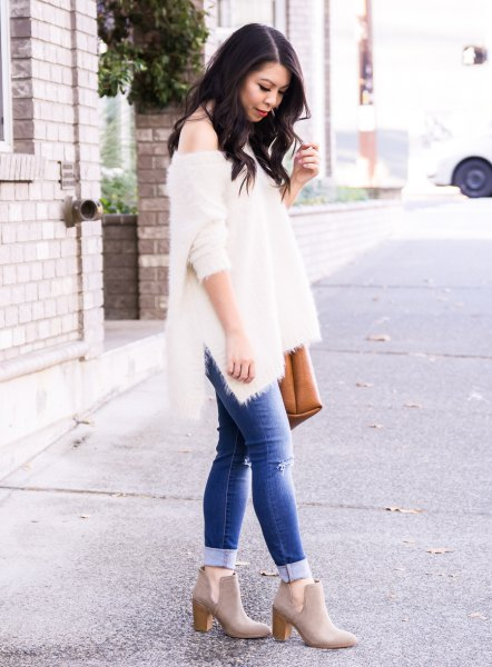 white one shoulder knit sweater blue cuffed jeans