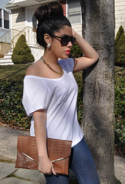white one shoulder tee with leather clutch bag chain necklace