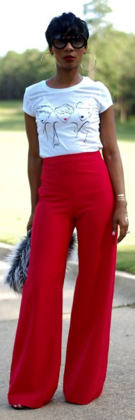 white print tee with red wide leg pants