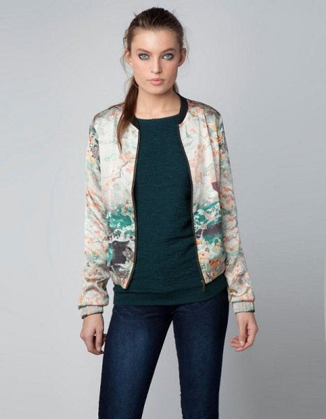 white printed bomber jacket with dark blue skinny jeans