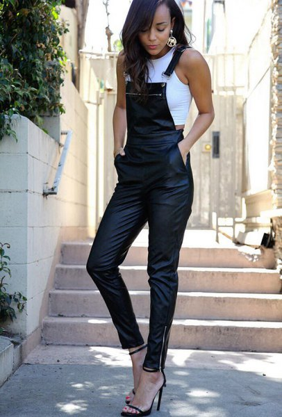 white sleeveless crop top with black leather skinny overall