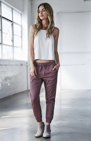 white sleeveless cropped top grey jogger pants