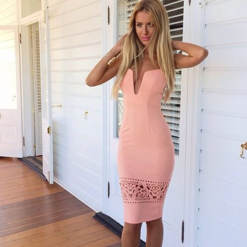 white tube bodycon midi dress with small cutout details