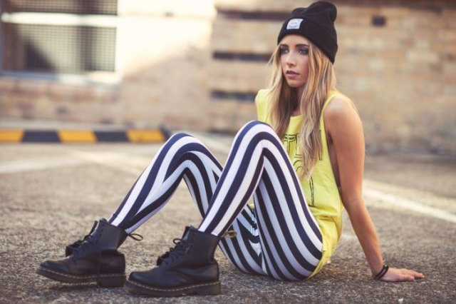 yellow printed tank top black and white striped leggings