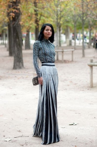 black and white patterned mock neck blouse with silver pleated maxi skirt