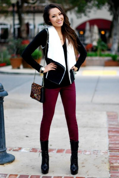 black and white shearling vest with brown skinny jeans and mid calf boots