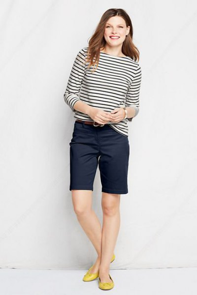 black and white striped long sleeve tee with navy knee length chino shorts
