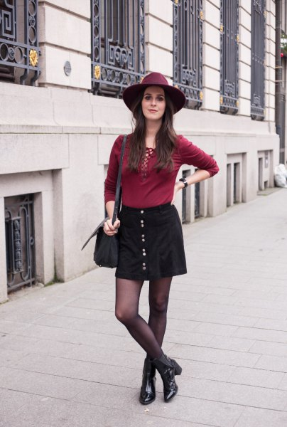 black button down mini skirt with burgundy lace up shirt