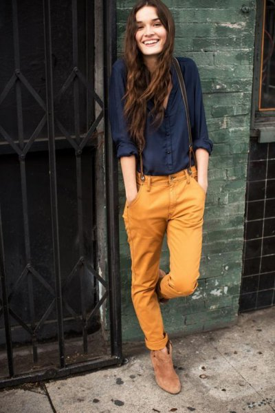 black button up shirt with mustard yellow jeans