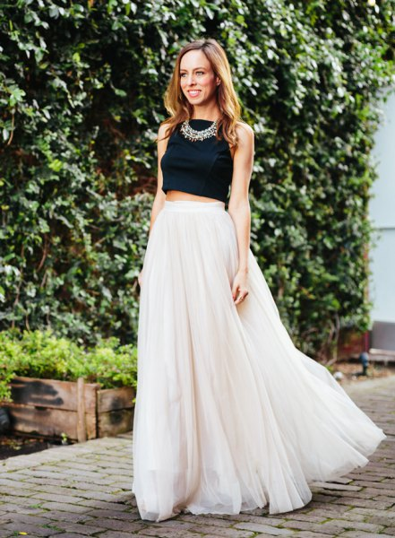 black cropped sleeveless top with blush pink long chiffon skirt