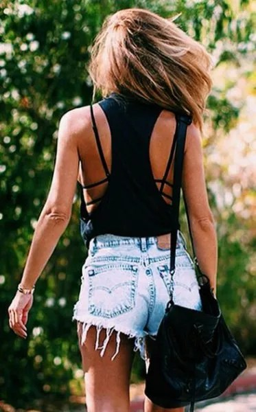 black cutout back top with mini denim shorts