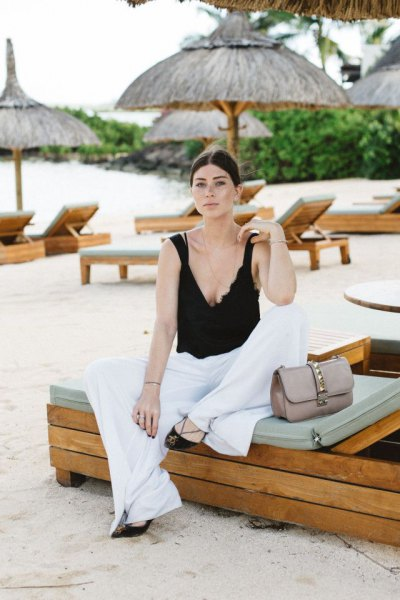 black deep v neck vest top with white palazzo pants