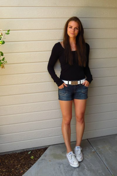 black form fitting sweater with denim shorts and white belt