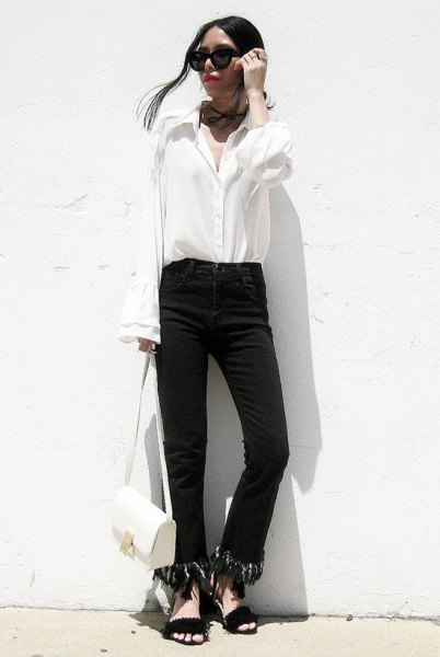 black fringe hem jeans with white button up bell sleeve shirt