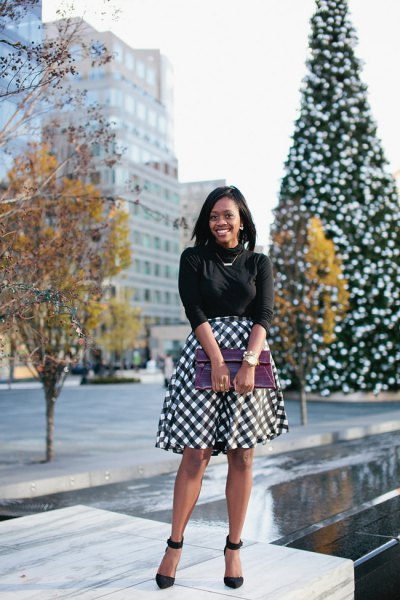 black half sleeve knit sweater with checkered midi flared skirt
