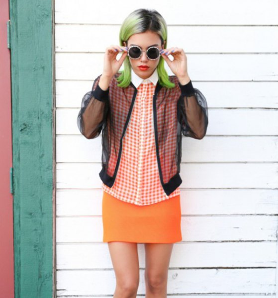 black jacket with plaid shirt and orange skirt