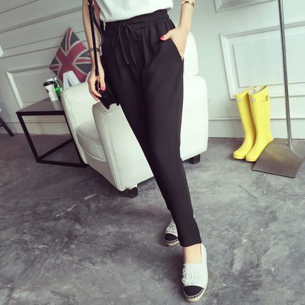 black jogger pants with white loafers