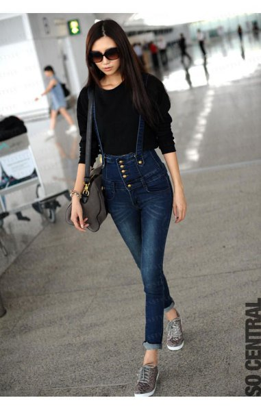 black knit sweater with dark blue button front suspender jeans