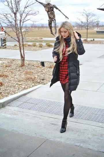 black long puffer coat with red and black plaid mini dress