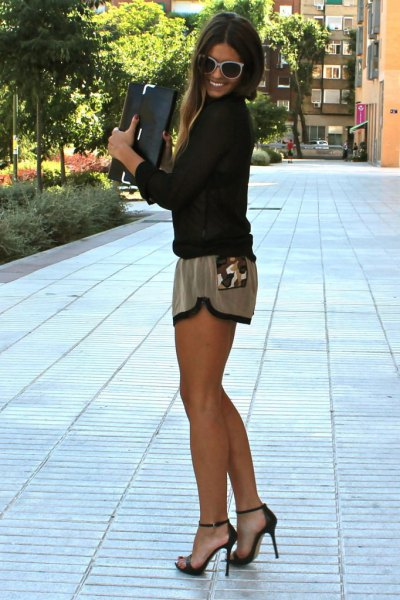 black long sleeve blouse with grey silk mini shorts