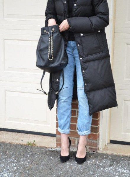 black midi length puffer coat with blue cuffed jeans