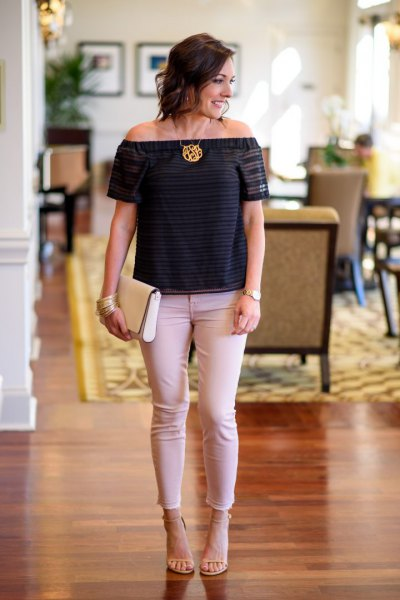 black off the shoulder tee with pale pink jeans