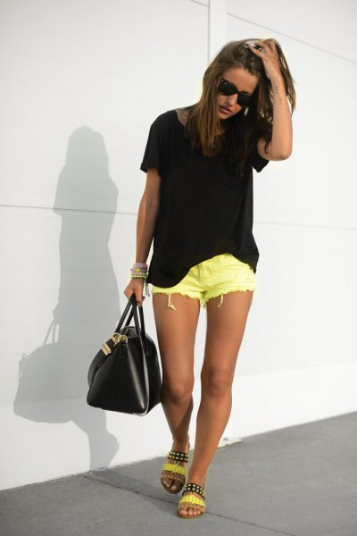 black oversized t shirt with yellow ripped denim shorts