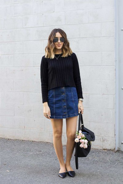 black ribbed knit sweater with dark blue button front denim mini skirt