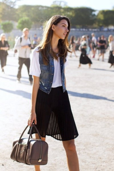 black semi sheer mini pleated skirt with white tee and denim vest