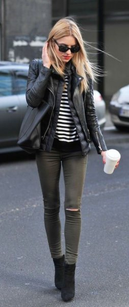 black short boots with leather jacket and grey skinny jeans