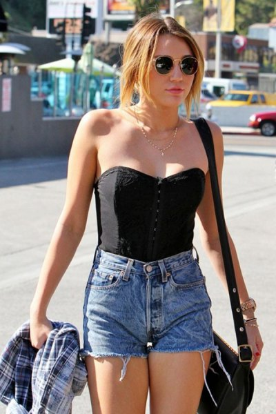 black strapless sweetheart top with high waisted blue mini denim shorts