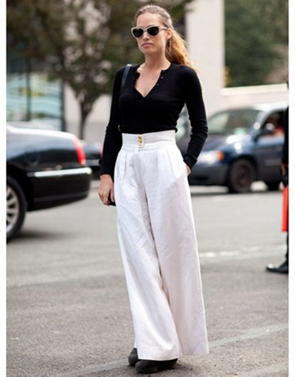 black v neck fitted sweater with white palazzo pants