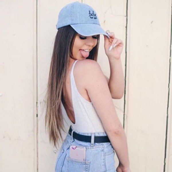 blue denim baseball cap with white tank top and high waisted shorts
