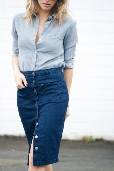 blue linen button up shirt with knee length denim skirt