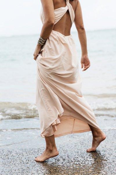 blush cutout back maxi dress with silver cuff bracelet