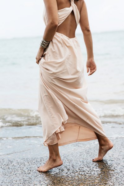 blush cutout back maxi dress with silver cuff bracelet