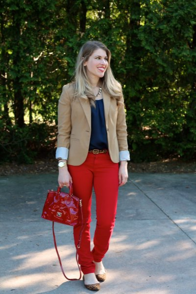 blush pink blazer with navy blouse and red belt