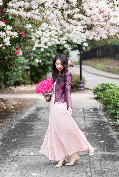 blush pink maxi pleated flared dress with black leather jacket