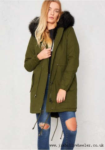 brown fur lined parka coat with ripped jeans