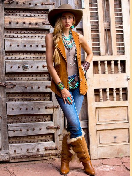 camel vest jeans and knee high boots