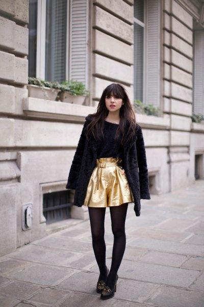 gold flowy shorts with black teddy coat