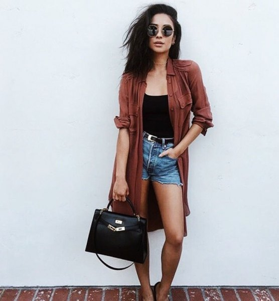 green long trench coat with black vest top and high waisted denim shorts