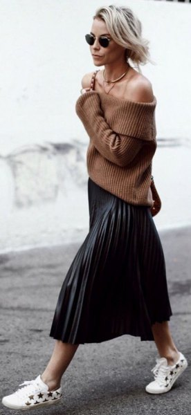 green off the shoulder ribbed sweater with black midi pleated skirt