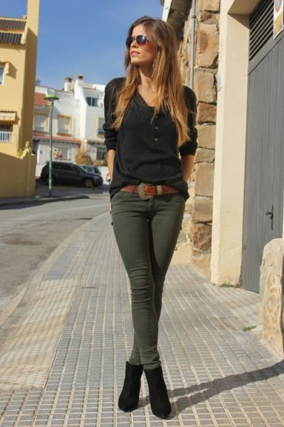 green skinny khaki jeans with black button front sweater