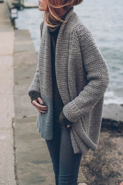 grey chunky knit cardigan with mock neck sweater and skinny jeans