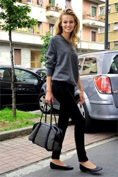 grey crew neck knit sweater with black skinny pants and leather ballet flats