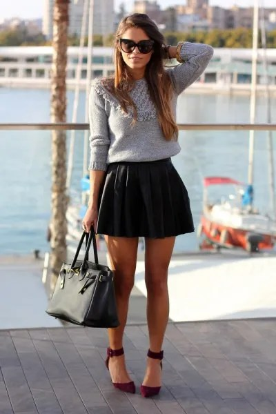 grey knit sweater with black leather mini pleated skirt