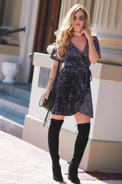 grey mini velvet wrap dress with black thigh high boots