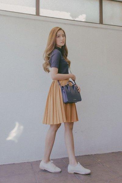 grey mock neck short sleeve top with orange pleated skater mini skirt
